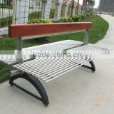 Stainless steel park bench seating with cast iron bench legs and wood backrest