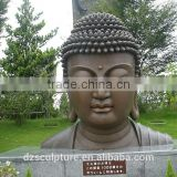 temple garden building metal brass buddha head statues