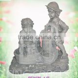 Resin boy and girl garden fountain