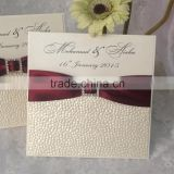 New arrival attractive & unique embossed paper white wedding invitations with wine ribbons & crystal brooches