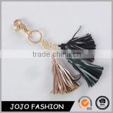 Best selling gold metal multicolor leather tassel keychain                                                                                                         Supplier's Choice