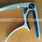 Newly Created Guitar Capo in Wooden Color With Screwdriver Design and Teeth Shaped Silicone Directly From Factory