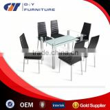 Clear glass dining table and chairs