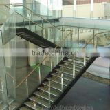interior U shape steel stringers stairs with rubber wood treads and glass railings