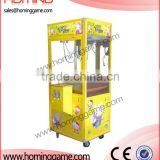 Hot sale crane game machine/Toy Story Crane Game Machine /Yellow Sponge Baby Toy Crane Machine