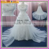 lace A-line wedding dress with long tulle train and shawl