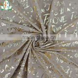 Custom Newest Design!!!High Quality 4 Way Stretch Polyamide Elastane Fabric Elastic Letter Gold Foil Dress Fabric
