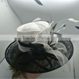 Black and white sinamay church hat with feather