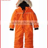 Child padded overalls orange for outdoor or ski with hoody and fur trim