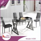 Foshan modern metal base 9mm thick rectangle black lacquer tempered glass dining table for 4 person