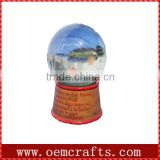 Funny wholesale glass snow globe souvenirs