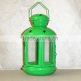 green metal lantern with clear glass wall