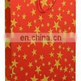 BDPP PREMIUM GIFT PAPER CARRY BAGS-GOLD PRINT ON STRAWBERRY RED BASE(PACK OF 10) -SIZE-16*11 INCHES/BEST RED COLOUR STAR PRINTED