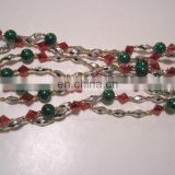 9 FOOT RED, GOLD, SILVER, AND GREEN STRUNG BEAD GARLAND