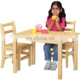 School and kindergarten kids study wooden table and chairs set