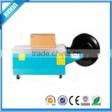 Low-profile semi-automatic balers hot melt strapping machine