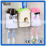 Hot sell automatic toothpaste dispenser for christmas gift , innovative children toothpaste dispenser/squeezer