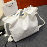 White canvas weekender bag with tote handle
