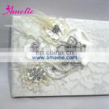 AW0707 Feather, pearls and rhinestones decorated ivory guest book