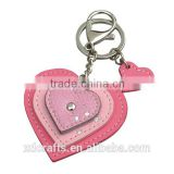 pink color leather keychain with mini heart
