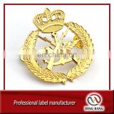 OEM Factory High Quality Wings And Guns Style And Casted Type Cluth On Back Custom Metal Gold Military Badge