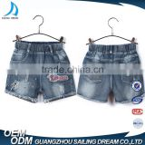 China apparel factory elastic ribbon waistband kids printed shorts jeans with hole