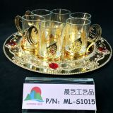Glass cup with gold tray