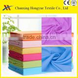 Solid bed sheet fabric Microfiber dyed textile fabric 100%polyester brushed bleach fabric for brazil market