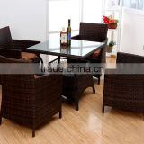 pe rattan tempered glass square table set with four rattan armchairs living room furniture