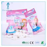 2017 fashion color bag pack mini magic coin compressed napkin tissue wholesaler in China