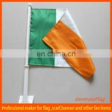 Small green white orange car window flags