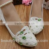 The pearl chain is low with white bridesmaid shoes and the wholesale bridal shoes are taken by the wholesale bride dress WS027