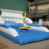 Inflatable surf board/inflatable surf simulator
