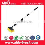 Telescopic flow-through car wash brush