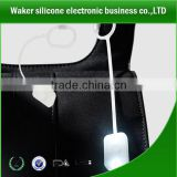 china wholesale growing in dark silicone led bag light handbag led light