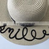 Fashion new design paper straw summer hat with wide brim and slogan words in sequins to decorate for girl and lady