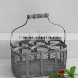 Antique gray metal wine basket for bottle