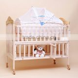 Wooden baby crib with mosquito net