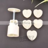 BAKEST Chinese kitchen tools Heart shaped ABS plunger moon cake mold set with various designs