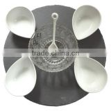 white porcelain plate with slate appetizer set