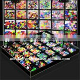 Display box with 2000 pcs. of assorted acrylic body Jewelry parts (balls, cones, dices) in size 3mm