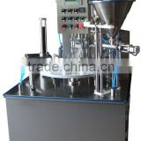 Portion cup automatic filling and sealing machine
