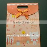 Cute gift paper bags with ribbon handle
