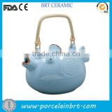 Fish design ceramic teapot with bamboo handle
