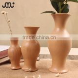 Small polished natural wooden decoration vase