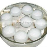white color floating golf ball