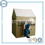 Kids play cardboard furniture in house shape, paper house, big playhouse