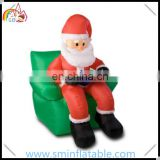 Portable inflatable santa claus, inflatable santa sitting in chair, santa claus reading on sofa for Christmas ornament