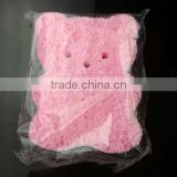 Cut pink PVA facial cleaning sponge