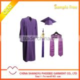 Purple graduation gown cap with tassels and stole